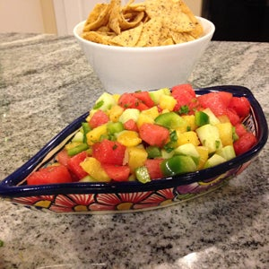Dish of watermelon pineapple salsa with tortilla chips