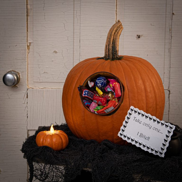 trick or treat display using candy holder from pumpkin