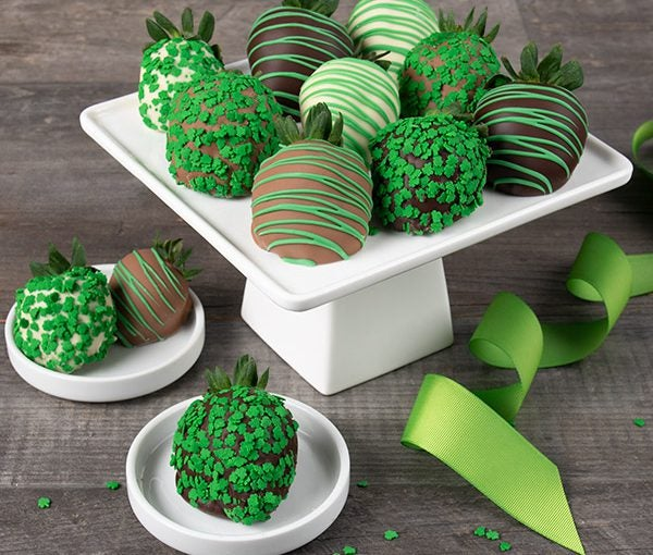 chocolate covered strawberries with green St. Patrick's Day decorations